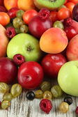 Assortment of juicy fruits, on wooden background — Stock Photo