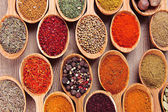 Assortment of spices in wooden spoons close-up — Stock Photo