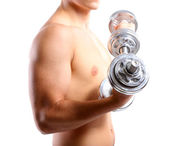 Handsome young muscular sportsman execute exercise with dumbbells, isolated on white — Stock Photo