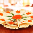 Stock Photo: Delicious pancakes with red caviar on table in cafe