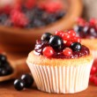 Tasty muffins with berries on wooden table — Stock Photo #29906073