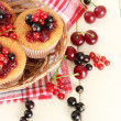 Tasty muffins with berries on white wooden table — Stock Photo #29906325
