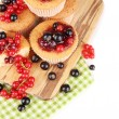 Stock Photo: Tasty muffins with berries isolated on white