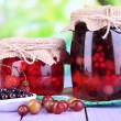 Home made berry jam on wooden table on bright background — Stock Photo #29906373