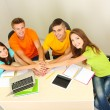 Group of young students sitting in room — Stock Photo #29906417
