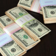 Stock Photo: Stacks of money on wooden table