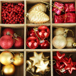 Wooden box filled with christmas decorations, isolated on white — Stock Photo #29906589