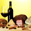 Exquisite still life of wine, cheese and meat products — Stock Photo #29907281
