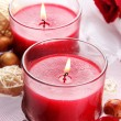 Beautiful red candles with flower petals in water — Stock Photo