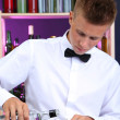 Stock Photo: Bartender is pouring vodkinto glass