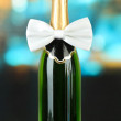 White bow tie on champagne bottle on bright background — Stock Photo #29907861