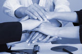 Close up of business people hands during teamwork in shades of grey — Stock Photo