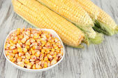 Fresh corn vegetable on wooden table — Stock Photo