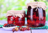 Home made berry jam on wooden table on bright background — Stock Photo