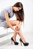 Girl with sore foot isolated on white — Stock Photo