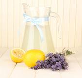 Lavender lemonade, on white wooden background — Stock Photo