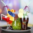 Set of different drinks on tray, on bright background — Stock Photo #29993487