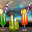 Stock Photo: Set of different drinks on bright background