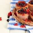 Stock Photo: Tasty muffins with berries on white wooden table