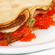 Stock Photo: Delicious pancakes with red caviar on plate close-up