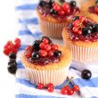 Tasty muffins with berries on white wooden table — Stock Photo #29997817