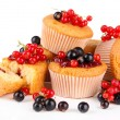 Tasty muffins with berries isolated on white — Stock Photo #29997879