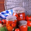 Stock Photo: Tasty canned and fresh tomatoes on wooden table