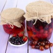 Home made berry jam on wooden table — Stock Photo #29998213