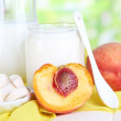 Stock Photo: Fresh dairy products with peaches on wooden table on natural background