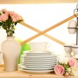 Lots beautiful dishes on wooden shelf on natural background — Stock Photo #29998903