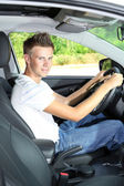 Young man in his new car — Stock Photo