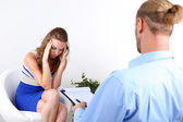 Woman with problem on reception for psychologist — Stock Photo
