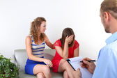 Sisters with problem on reception for psychologist — Stock Photo