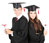Iki mutlu mezun öğrencilerin üzerinde beyaz izole — Stok fotoğraf