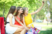 Three beautiful young woman taking picture in summer park — Foto de Stock