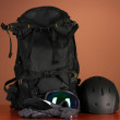 Winter sport glasses, helmet and gloves, backpack, on brown background — Stock Photo #30008413