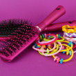 Scrunchies, hairbrush and hair - clip on pink background — Stock Photo #30008755