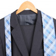 Stock Photo: Suit and tie on hanger on white background