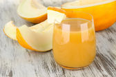 Delicious juice of melon on table close-up — Stock Photo