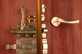 Metal bolts, latches and hooks in wooden open door close-up — Stock Photo