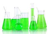 Provette con liquido verde isolato su bianco — Foto Stock