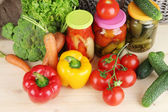 Fresh vegetables and canned on wooden table close up — Stock Photo
