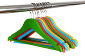 Colorful clothes hangers isolated on white — Stockfoto