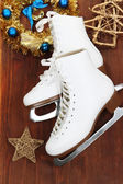 Figure skates on table close-up — Stock Photo
