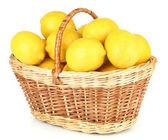 Ripe lemons in wicker basket isolated on white — Stock Photo