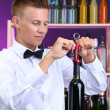 Bartender opens bottle of wine — Stock Photo #30010187