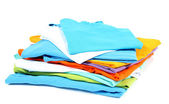 Neatly folded shirts isolated on white — Stock Photo