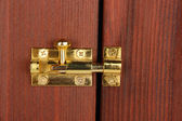 Metal latch in wooden door close-up — Stock Photo