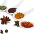 Assortment of spices in  white spoons, isolated on white — Stock Photo
