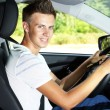 Young man in his new car — Foto Stock